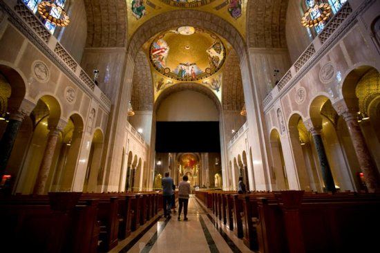 Tourists are seen at the Basilica of the National Shrine of the Immaculate Conception in Washington Oct. 6. The mosaic ornamentation of the interior of the dome is scheduled for a December 2017 completion. CNS photo/Tyler Orsburn