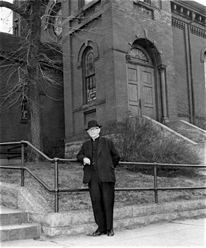 Father John O'Neill, a longtime pastor of St. Michael pictured in front of the parish's West Side church in 1966, moved the parish from St. Paul's West Side to West St. Paul in the 1950s. Photo courtesy the Pioneer Press