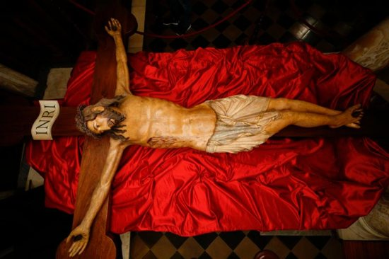 A wooden crucifix from the 14th century is pictured during a media opportunity to showcase its restoration in St. Peter's Basilica at the Vatican Oct. 28. The crucifix is one of the few items that was present in the original St. Peter's Basilica. The restoration was funded by the Knights of Columbus. CNS photo/Paul Haring