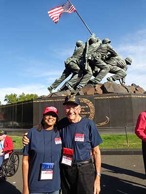 World War II veteran Carl Muscarello of All Saints Parish in Sunrise, Florida, and his guardian, Sandy Thomas, pose Oct. 29 in front of the Iwo Jima Memorial in Arlington, Va., across the Potomac River from Washington. CNS/courtesy The Florida Catholic