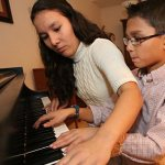 Four pianos and counting fuel family's piano-playing passion