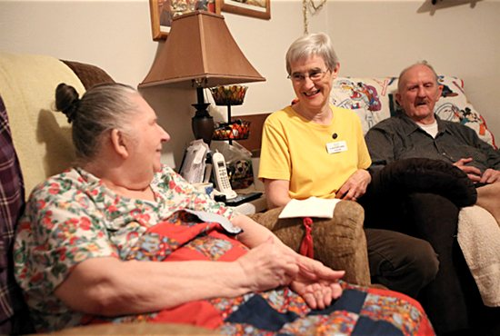 School Sister of Notre Dame Bernadette Welter, center, visits with Jane and George Joyner in their St. Paul home Nov. 30. Sister Bernadette works as a homemaker for the couple with West 7th Keystone Community Services in St. Paul. Dave Hrbacek/The Catholic Spirit
