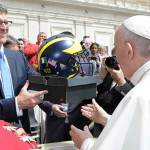 Michigan head coach says meeting pope was 'emotional'