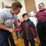 Knights, Birk kick off Super Bowl week with coat donations