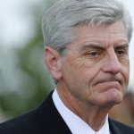 Mississippi governor signs 15-week abortion ban; clinic files suit