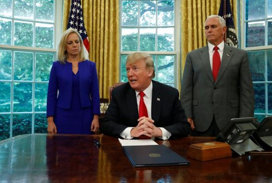 President Donald Trump is seen with with Secretary of Homeland Security Kirstjen Nielsen and Vice President Mike Pence at the White House June 20