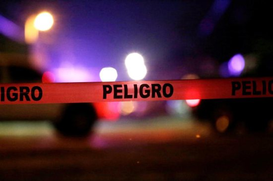 "Police tape that reads ""Danger"" is seen at a crime scene in Ciudad Juarez, Mexico"