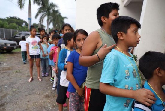 Children wait in line at a shelter in Escuintla, Guatemala, June 4. The eruption of the nearby volcanic eruption a day earlier killed at least 69 people
