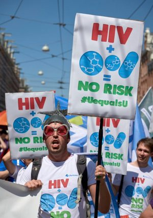 Participants march July 23 through the streets of Amsterdam, marking the opening of the 2018 International AIDS Conference.