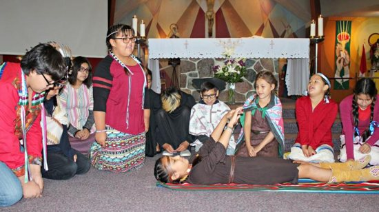 Young people from Our Lady of Seven Sorrows Parish in Maskwacis, Alberta, perform a play based on the life of St. Kateri Tekakwitha.