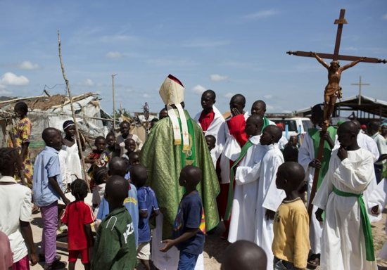 Cardinal Dieudonne Nzapalainga of Bangui, Central African Republic, greets youths after celebrating Mass for internally displaced people in Bangui in this 2015 file photo.
