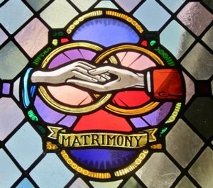 A stained-glass window in Espiritu Santo Catholic Church in Safety Harbor, Fla., depicts a married couple's union. Vatican calls for balance in marriage preparation