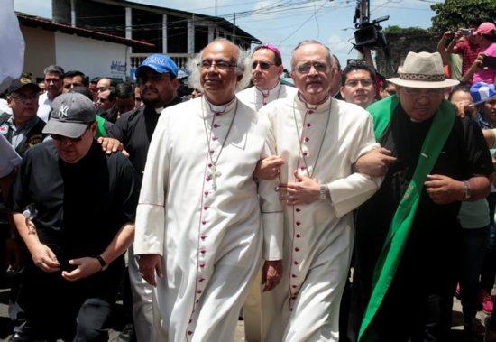 Cardinal Leopoldo Brenes Solorzano of Managua, Nicaragua, and Auxiliary Bishop Silvio Baez Ortega, arrive as anti-government protests continue July 9 in Diriamba.
