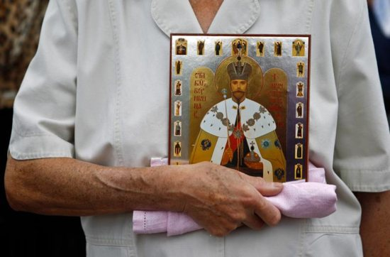 An Orthodox woman holds a portrait of Czar Nicholas II during a 2012 gathering in Moscow.
