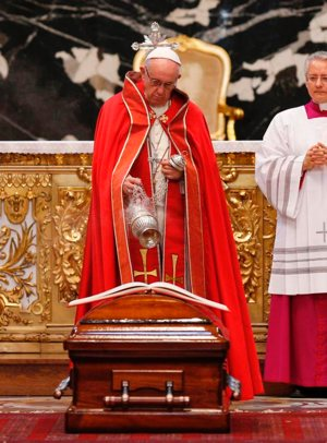 Pope Francis uses incense to bless the casket of French Cardinal Jean-Louis Tauran during his funeral Mass in St. Peter's Basilica at the Vatican July 12.