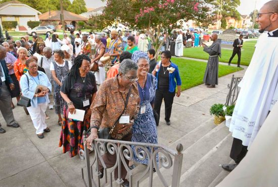 Women religious from the National Black Sisters Conference process into St. Raymond-St. Leo the Great Parish Church in New Orleans July 30.