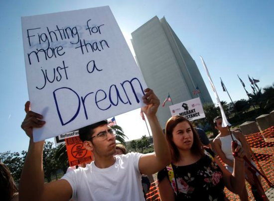 "A protester holds a sign that reads ""Fighting for more than just a Dream,"" as he joined Dreamers and hundreds of demonstrators calling for Deferred Action for Childhood Arrivals, or DACA"