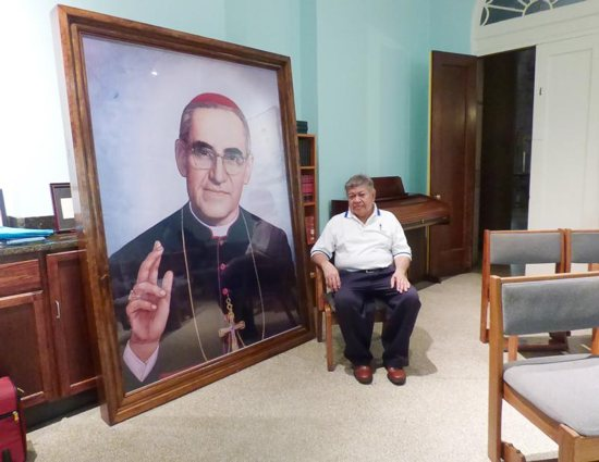 Marcelo Perdomo is seen Aug. 2 at the Shrine of the Sacred Heart in Washington holding a framed thank-you letter sent to him by Blessed Oscar Romero.