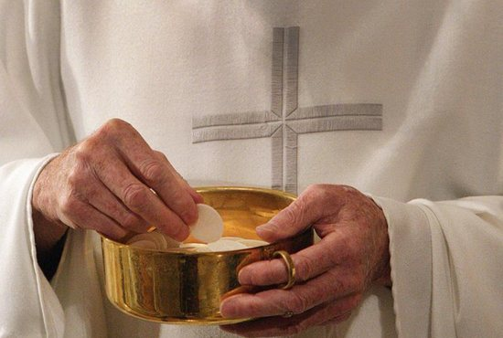 By receiving the Eucharist at Mass, Christians are given Christ's same spirit and a taste of eternal life, Pope Francis said Aug. 19 during the Angelus.