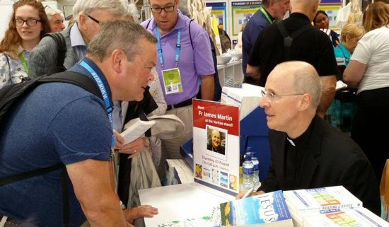 Jesuit Father James Martin, a popular author and editor at large of America magazine, greets attendees at a book signing