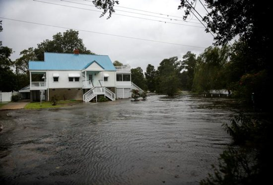 Floodwaters from the Neuse River are seen next to a home in New Bern, N.C., Sept. 13 ahead of Hurricane Florence making landfall in the Carolinas. The hurricane Florence is poised to affect more than 10 million people in the southeastern U.S.
