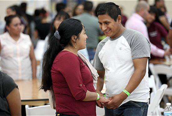 "A Latino couple talk and pray during ""Encuentro Familiar,"" or Family Encounter: The Family in the Plan of God"