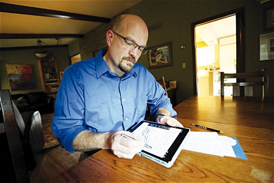 Louis Hall works on a comic Sept. 17 at his home in Mendota Heights.