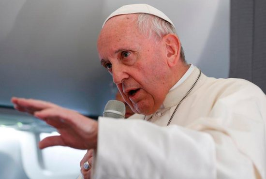 Pope Francis answers questions from journalists aboard his flight from Tallinn, Estonia, to Rome