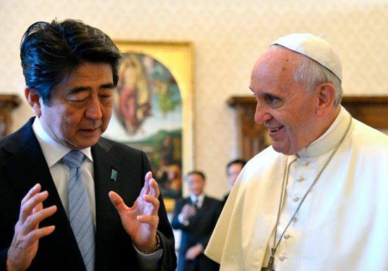 Japanese Prime Minister Shinzo Abe gestures next to Pope Francis during a 2014 private audience at the Vatican.