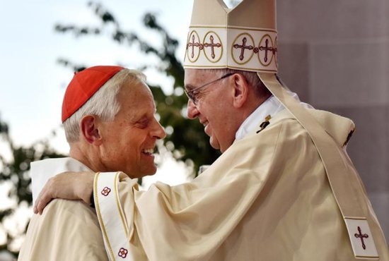 Pope Francis greets Washington Cardinal Donald Wuerl during a Mass in 2015 outside the Basilica of the National Shrine of the Immaculate Conception in Washington. Cardinal Wuerl announced Sept. 11 that he will meet soon with Pope Francis to discuss the resignation he submitted three years ago when he turned 75.