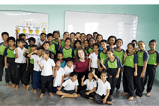 Grace Baldus, center in red, poses with the refugee school students Oct. 10, 2017, her final day serving at New Thessalonians Apostolate School for Refugee Children in Alor Setar, Malaysia