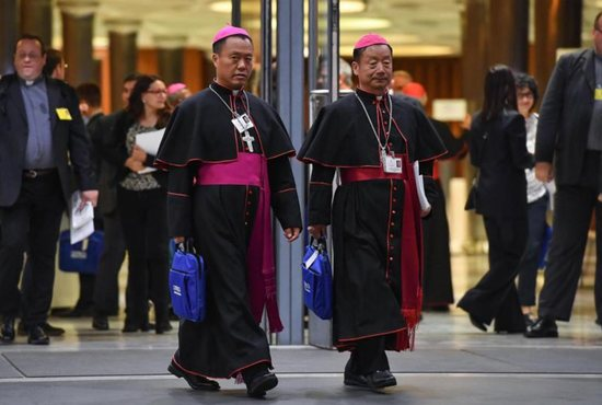 Chinese Bishops Joseph Guo Jincai of Chengde and Coadjutor Bishop John Baptist Yang Xiaoting of Yan'an depart the opening session of the Synod of Bishops on young people, the faith and vocational discernment