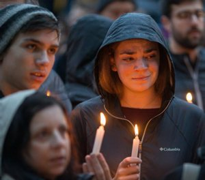 People mourn during a candlelight vigil Oct. 27 for victims of the shooting that killed eleven people at the Tree of Life Synagogue in Pittsburgh. Robert Bowers opened fire that morning during a service at the synagogue, also wounding at least six others, including four police officers, authorities said.