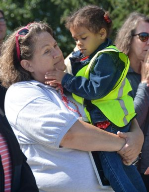 Linda Kile holds Larelle Thompson during a 40 Days for Life rally Sept. 26 at the Planned Parenthood facility in Indianapolis. Kile helped save Larelle from being aborted at the same facility three-and-a-half years ago.