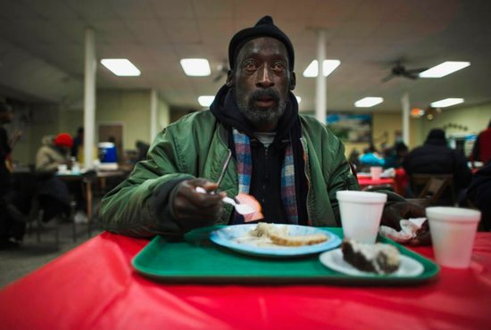 A man eats his lunch at a soup kitchen in the basement of St. Leo Catholic Church in Detroit. Leaders at U.S. Catholic organizations are cautiously monitoring the level of donations to ministries as the end-of-the-year giving season approaches, hoping that the clergy sexual abuse scandal won't negatively affect their bottom line.