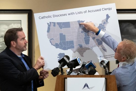 Attorney Jeffrey Anderson points to an illustration during a Nov. 14 press conference in Baltimore. Anderson is suing the U.S. Conference of Catholic Bishops.