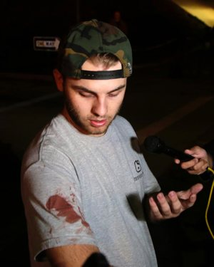 Matt Wennerstorm, seen with blood on his shirt, talks to the media Nov. 8 outside the Borderline Bar and Grill in Thousand Oaks, Calif. The gunman, who opened fire without warning late Nov. 7, was found dead inside the establishment, authorities said.