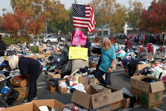 People visit a free clothing donation site for victims of the Camp Fire in Chico, Calif., Nov. 18. Pope Francis at his Sunday Angelus Nov. 18 prayed for the victims of the California wildfires.