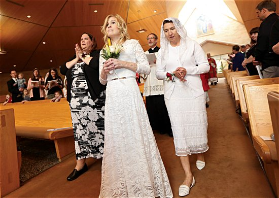 Jackie Hintze, center, leads the procession at the start of her consecration Mass Sept. 14 at St. Hubert in Chanhassen.