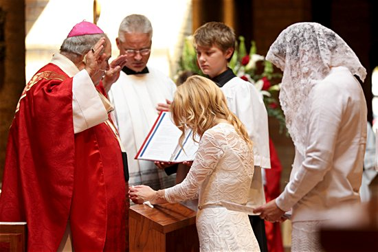 Archbishop Bernard Hebda prays a blessing over Jackie Hintze during her consecration Mass Sept. 14 at St. Hubert in Chanhassen.