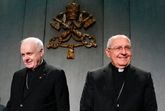 U.S. Cardinal Edwin F. O'Brien, grand master of the Knights of the Holy Sepulchre, and Cardinal Leonardo Sandri, prefect of the Congregation for Eastern Churches, arrive for a press conference at the Vatican Nov. 7. The Knights are preparing for a major meeting in Rome.