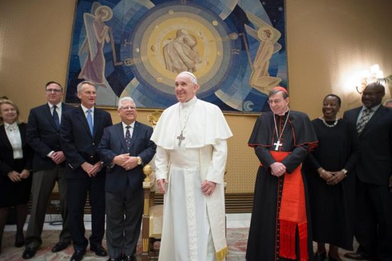 Pope Francis meets with members of the American Bible Society during a private audience at the Vatican