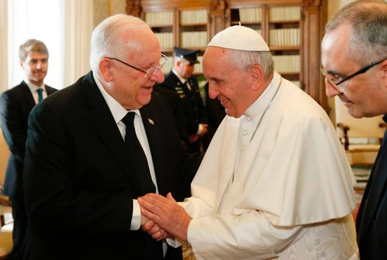 Pope Francis shakes hands with Israeli President Reuven Rivlin during a private audience at the Vatican