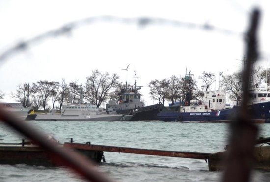 Three Ukrainian naval ships, recently seized by Russia's security service, are seen anchored in a port in Kerch, Crimea. Catholics in Ukraine said they fear a full-scale war with Russia.