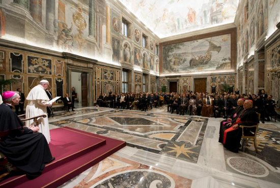 Pope Francis meets Dec. 14 with organizers and artists who will perform in a benefit Christmas concert at the Vatican. The concert proceeds will be donated to two organizations: Scholas Occurrentes in Iraq and the Don Bosco Mission in Uganda