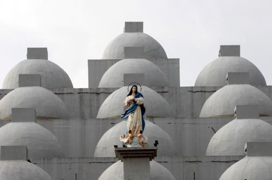 A statue of Mary is seen in 2017 atop the Cathedral of Managua in Nicaragua. A 24-year-old woman dumped sulfuric acid on a priest while he was hearing confessions in the cathedral Dec. 5.