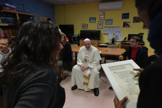 Pope Francis visits mentally disabled people at Il Ponte e l'Albero community on the outskirts of Rome Dec. 7. The visit continued the pope's tradition of doing Friday works of mercy.