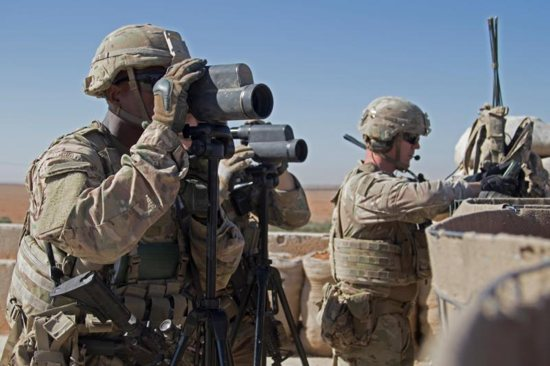 U.S. soldiers surveil the area during a combined joint patrol Nov. 1 in Manbij, Syria.