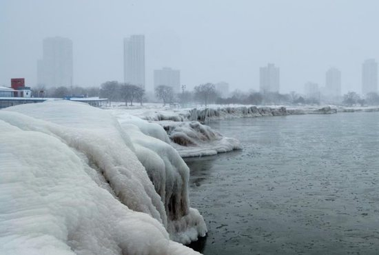 The banks of Lake Michigan are seen frozen with the Chicago skyline in the background Jan. 29, 2019, as bitter cold sweeps across much of the central and eastern United States. Hundreds of schools and several large universities closed their campuses Jan. 29 as temperatures plummeted across the Midwest, with forecasters warning that the frigid weather would get worse and could be life-threatening.