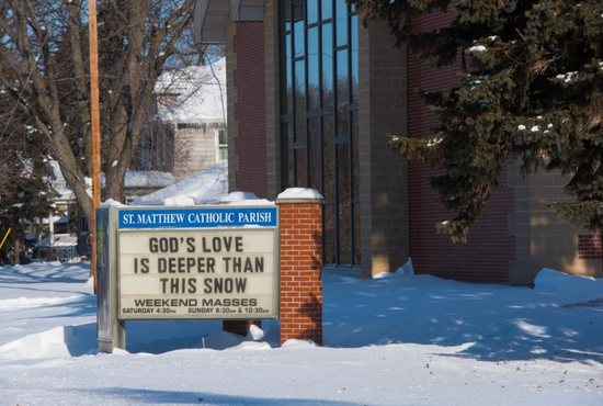 A marquee outside of St. Matthew Church in Allouez, Wis., offers a warm message to passers-by Jan. 30, 2019. Catholic schools and parishes were closed Jan. 30 and 31 due to extremely cold temperatures. A polar vortex brought wind chill temperatures to around minus-40 degrees both days.